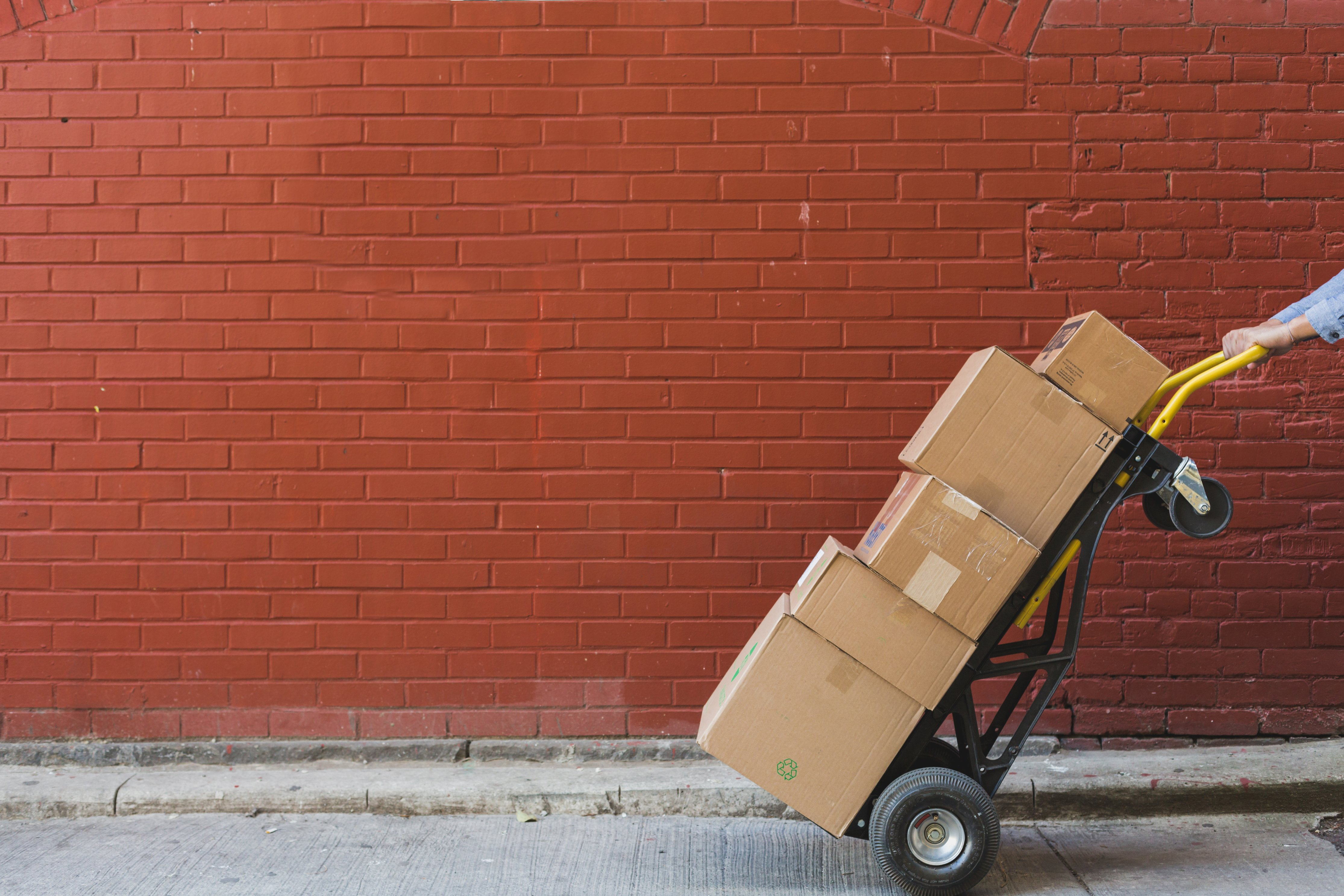 shipping-boxes-in-front-of-red-brick